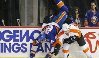 New York Islanders left wing Nikolay Kulemin (86) is upended over Philadelphia Flyers defenseman Radko Gudas (3) of the Czech Republic in the second period of an NHL hockey game in New York, Monday, March 21, 2016. (AP Photo/Kathy Willens)