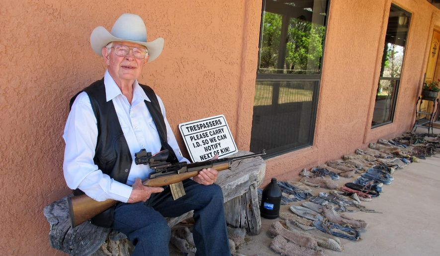 In this Tuesday, March 15, 2016 photo, Jim Chilton poses for a photo on the front porch of his home on his 50,000 acre ranch along the U.S-Mexico border in Arivaca, Ariz. (AP Photo/Brian Skoloff) ** FILE **