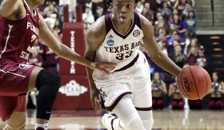 Florida State's Emiah Bingley, left, tries to slow down Texas A&M's Courtney Walker (33) during the first half of a college basketball game in the second round of the NCAA tournament Monday, March 21, 2016, in College Station, Texas. (AP Photo/Pat Sullivan)