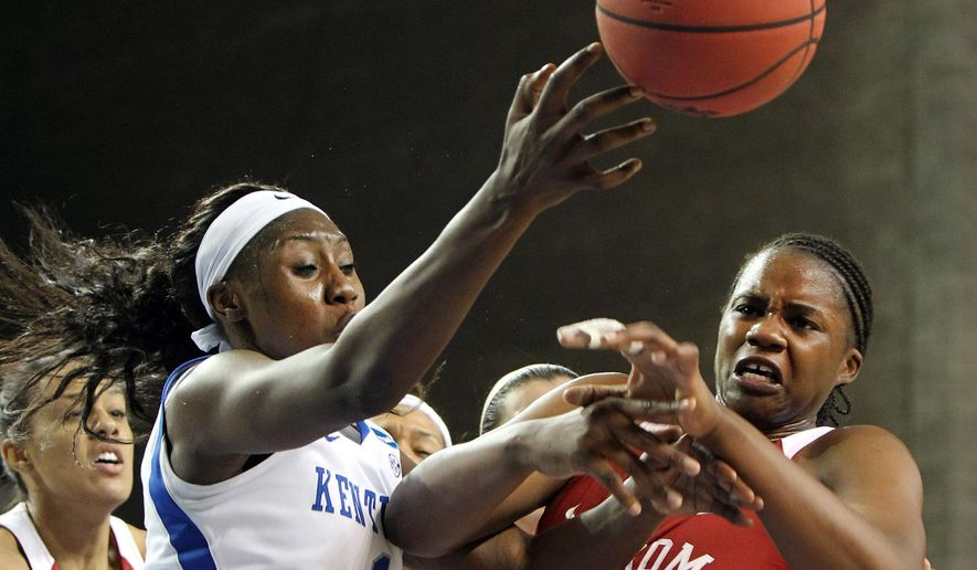 Oklahoma's Vionise Pierre-Louis, right, and Kentucky's Batouly Camara during a second round women's college basketball game in the NCAA Tournament in Lexington, Ky., Monday, March 21, 2016. (AP Photo/James Crisp)