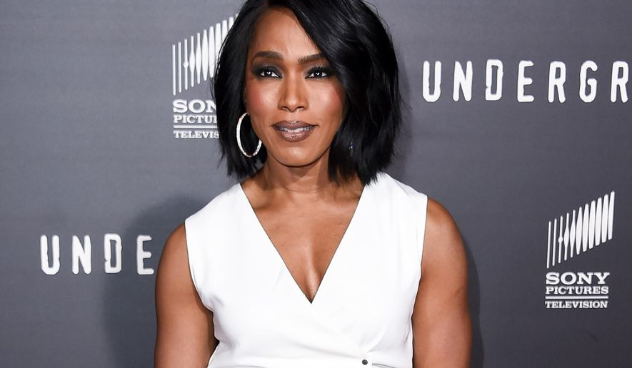 """FILE - In this March 2, 2016 file photo, Angela Bassett arrives at the LA Premiere of """"Underground"""" in Los Angeles. Bassett, Tina Fey, Jada Pinkett Smith, Cynthia Nixon and Kathie Lee Gifford are being recognized for their media achievements by the Alliance for Women in Media Foundation at its 41st annual Gracie Awards in May. (Photo by Richard Shotwell/Invision/AP, File)"""