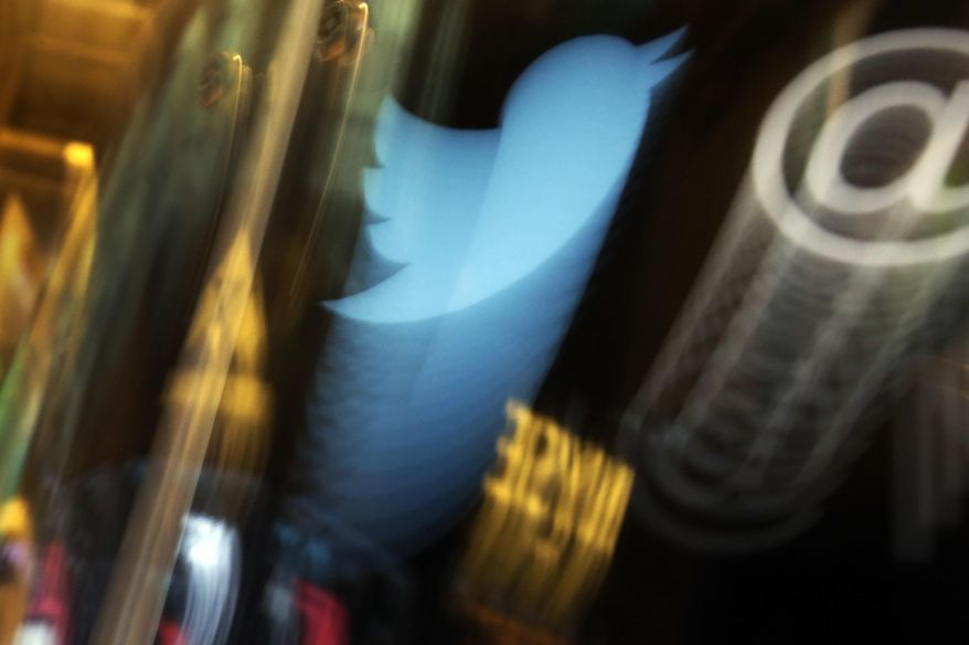In this Wednesday Nov. 6, 2013, file photo, the Twitter logo appears on an updated phone post on the floor of the New York Stock Exchange. (AP Photo/Richard Drew, File)