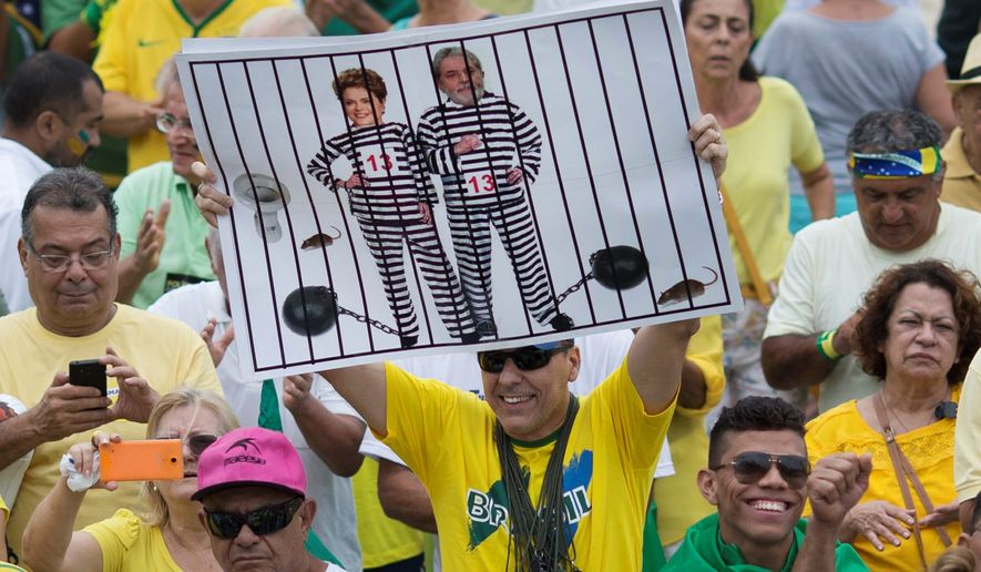 Protesters last week in Rio de Janeiro suggested that Brazilian President Dilma Rousseff and former President Luiz Inacio Lula da Silva belong in prison stripes. (Associated Press)