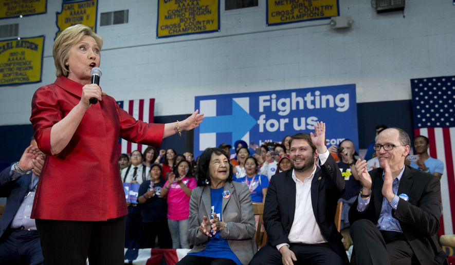 Democratic presidential candidate Hillary Clinton, joined by from left labor leader Dolores Huerta, and Rep. Ruben Gallego, D-Ariz., and Labor Secretary Thomas Perez, speaks during a campaign event at Carl Hayden Community High School in Phoenix, Monday, March 21, 2016. (AP Photo/Carolyn Kaster)