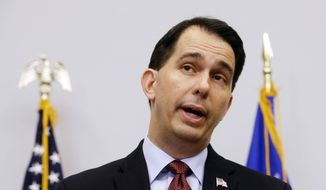 Wisconsin Gov. Scott Walker speaks Sept. 21, 2015, at a news conference in Madison, Wis., where he announced that he is suspending his Republican presidential campaign. (Associated Press) **FILE**
