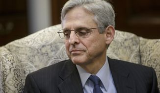 Judge Merrick Garland, President Barack Obama's choice to replace the late Justice Antonin Scalia on the Supreme Court, sits during a meeting with Sen. Robert Casey, D-Pa., on Capitol Hill in Washington, Tuesday, March 22, 2016. Garland, who sits on the U.S. Court of Appeals for the District of Columbia, is being blocked from a confirmation hearing by Senate Majority Leader Mitch McConnell, R-Ky., who has been steadfast in his refusal to advance any Supreme Court nominee during the waning months of Obama's presidency.  (AP Photo/J. Scott Applewhite)