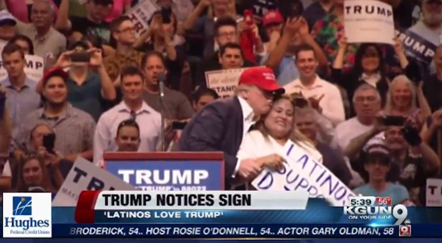 """Betty Rivas, a Latina business owner, is facing calls for a boycott after she held a """"Latinas support D. Trump"""" onstage Saturday at a Donald Trump rally in Tucson, Arizona. (KGUN9)"""