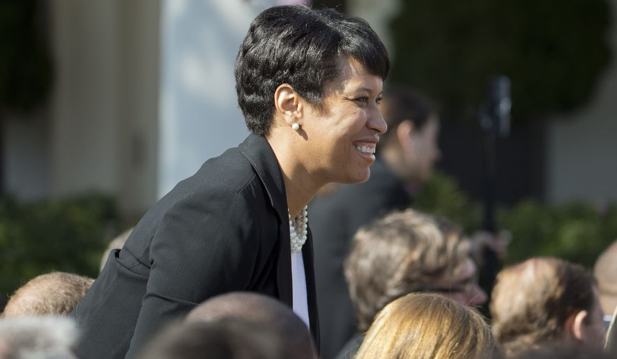 D.C. Mayor Muriel Bowser takes her seat before federal appeals court Judge Merrick Garland is introduced as President Barack Obama's nominee for the Supreme Court during an announcement in the Rose Garden of the White House, in Washington, Wednesday, March 16, 2016. (AP Photo/Pablo Martinez Monsivais)