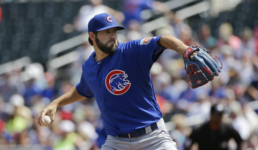 Chicago Cubs starting pitcher Jason Hammel throws against the Cincinnati Reds during the first inning of a spring training baseball game, Tuesday, March 22, 2016, in Goodyear, Ariz. (AP Photo/Jae C. Hong)