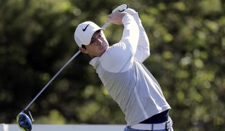 Defending champion Rory McIlroy, of Northern Ireland, hits from the second tee during practice for the Dell Match Play Championship golf tournament at Austin County Club, Tuesday, March 22, 2016, in Austin, Texas. (AP Photo/Eric Gay)