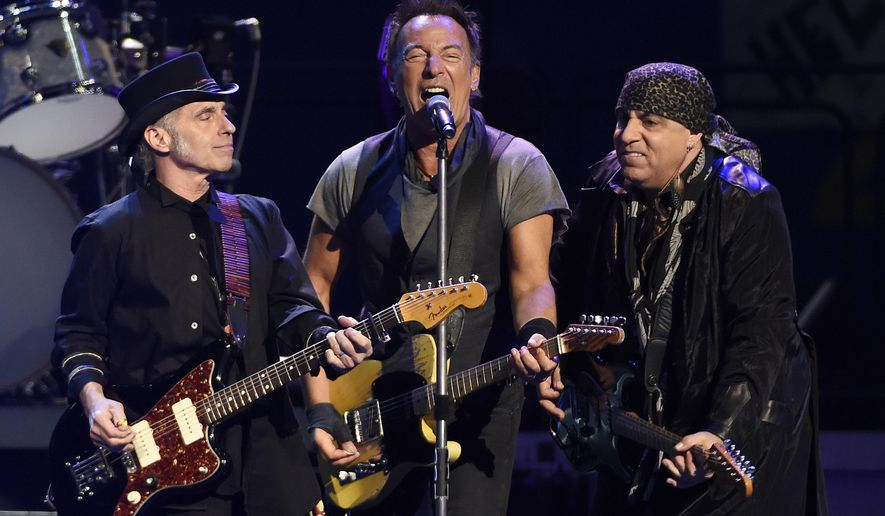 FILE - In this March 15, 2016 file photo, Bruce Springsteen, center, performs with Nils Lofgren, left, and Steven Van Zandt of the E Street Band during their concert in Los Angeles. Springsteen offered a free concert recording for a limited time after he had to postpone a New York City show due to snow. More than 100,000 copies were downloaded and it was the first time many music fans became aware of Nugs.net, a website that offers concert experiences to those who can't make it to the arena. (Photo by Chris Pizzello/Invision/AP, File)