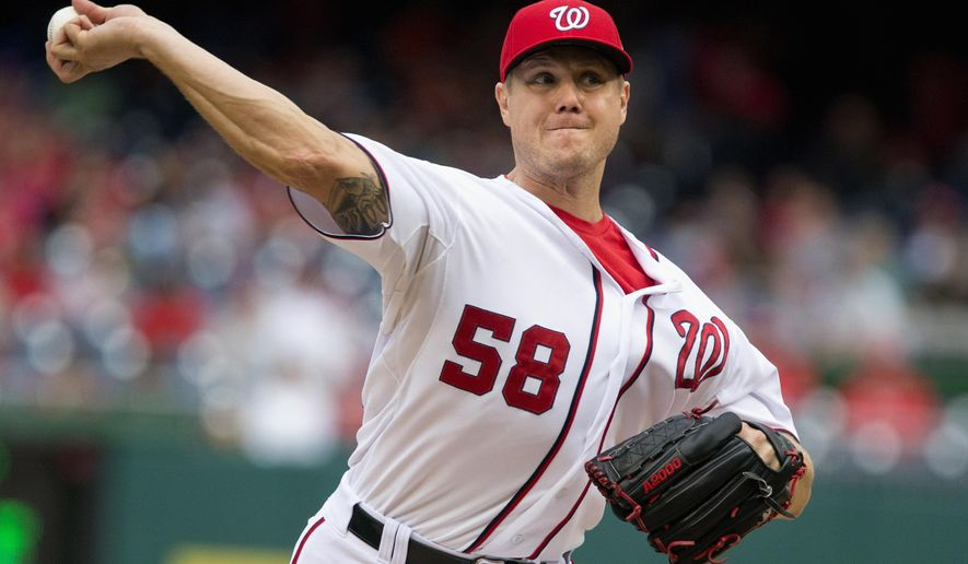 FILE - In this Sept. 27, 2015 file photo, Washington Nationals relief pitcher Jonathan Papelbon pitches against the Philadelphia Phillies at Nationals Park in Washington. The Nationals hope to become a good team again, but Papelbon being back with the Nationals less than six months since he went after teammate and National League MVP Bryce Harper in the dugout is stunning to many.  (AP Photo/Jacquelyn Martin, file)