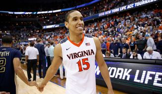 ACC player of the Malcolm Brogdon's defense of a surprise Butler scoring threat changed the second-round victory. (Associated Press)