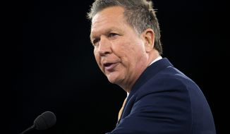 "Republican presidential candidate Ohio Gov. John Kasich, after recent poor showings in Arizona and Utah, is facing calls from his party to drop out, lest he act as a ""spoiler"" for to help out Donald Trump's ascendancy. (Associated Press)"