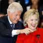 Former President Bill Clinton and Democratic presidential front-runner Hillary Clinton acknowledge supporters during a caucus night rally at Drake University in Des Moines, Iowa, on Feb. 1, 2016. (Associated Press) **FILE**
