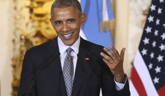 U.S. President Barack Obama shares a light moment during a joint news conference with Argentine President Mauricio Macri, at the Casa Rosada Presidential Palace in Buenos Aires, Argentina, Wednesday, March 23, 2016. Obama is on a two day official visit to Argentina. (David Fernandez/Pool Photo via AP)