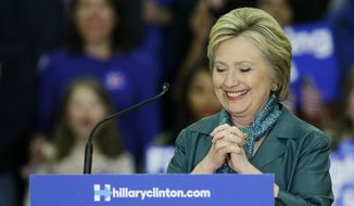 Democratic presidential candidate Hillary Clinton pauses while speaking Tuesday, March 22, 2016, during a campaign rally at Rainier Beach High School in Seattle. (AP Photo/Ted S. Warren)