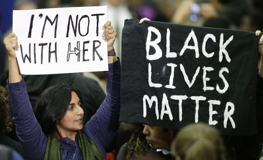 Black Lives Matter activists show opposition to Hillary Clinton. (Associated Press/File)