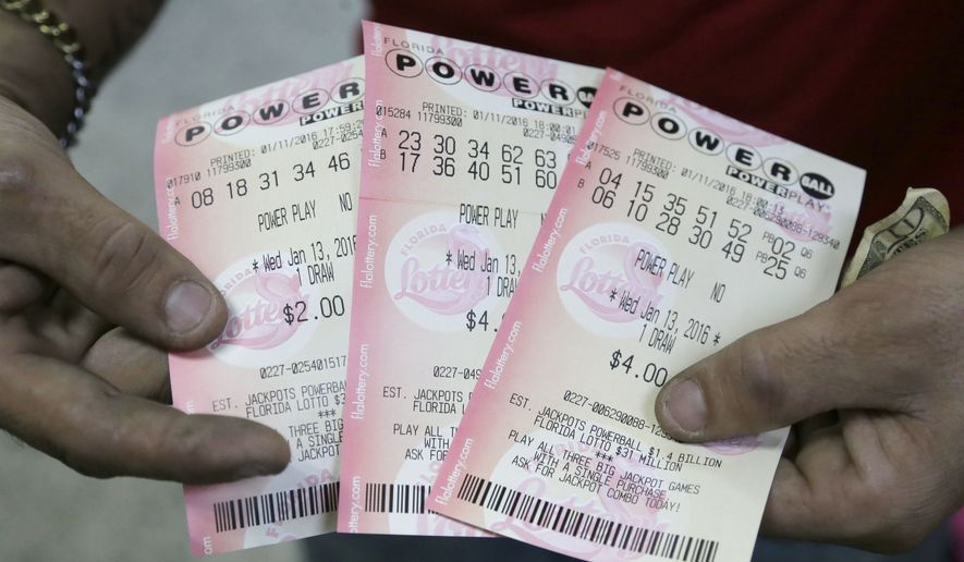 Powerball continued to build into big-jackpot territory Wednesday, as numbers were drawn again Wednesday night for a $282 million prize eight weeks after the last big winner. (AP Photo/Alan Diaz)