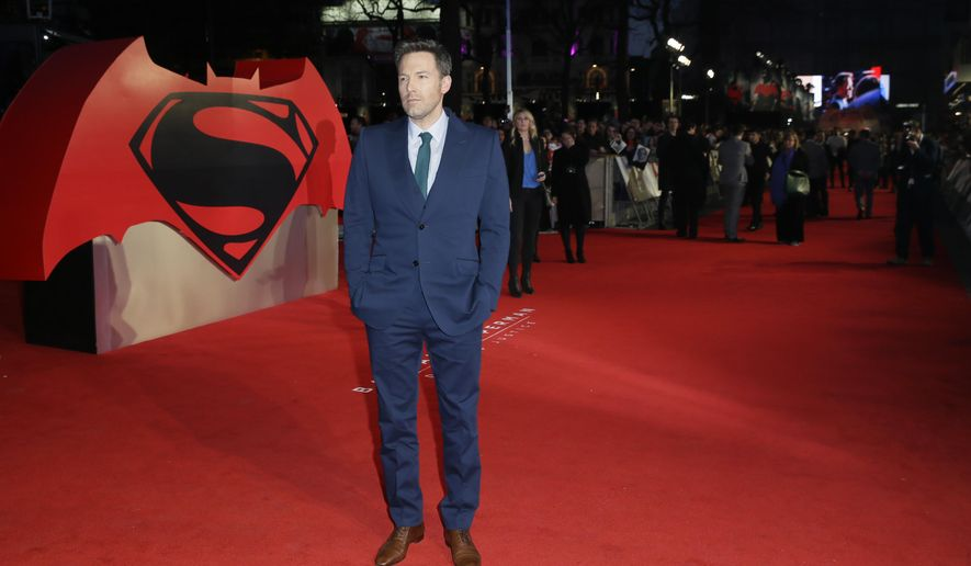 Actor Ben Affleck poses for photographers upon arrival at the premiere of the film 'Batman V Superman' in London, Tuesday, March 22, 2016. (Photo by Tim Ireland/Invision/AP)