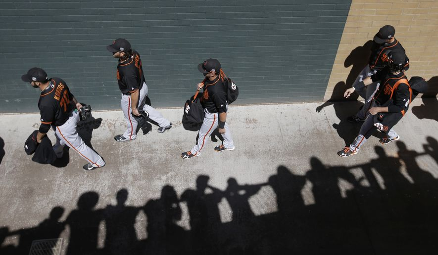 San Francisco Giants arrive for a spring training baseball game against the Arizona Diamondbacks, Wednesday, March 23, 2016, in Scottsdale, Ariz. (AP Photo/Darron Cummings)