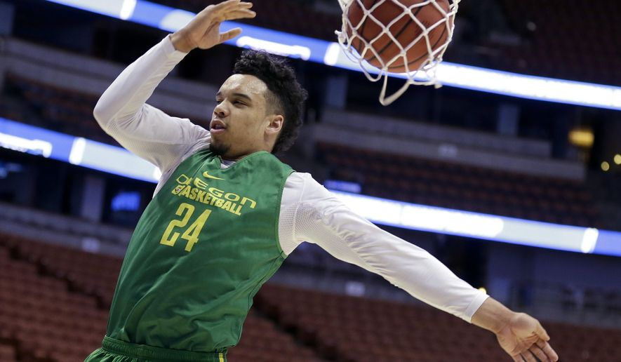 Oregon's Dillon Brooks comes down after shooting during college basketball practice in Anaheim, Calif., Wednesday, March 23, 2016. Oregon plays Duke in a regional semifinal in the NCAA Tournament on Thursday. (AP Photo/Chris Carlson)
