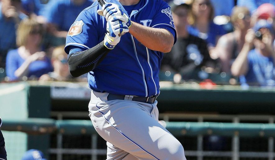 Kansas City Royals' Mike Moustakas watches the flight of his home run during the third inning of a spring training baseball game against the Cleveland Indians Wednesday, March 23, 2016, in Goodyear, Ariz. (AP Photo/Ross D. Franklin)