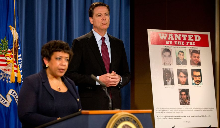 Attorney General Loretta Lynch, and FBI Director James B. Comey announce the indictments of seven Iranians tied to a series of punishing cyberattacks on a small dam outside New York City and dozens of financial institutions. (Associated Press) **FILE photo, March 24, 2016**