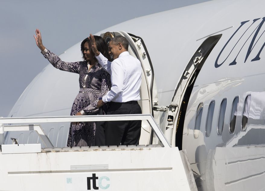U.S. President Barack Obama and his wife, First Lady Michelle Obama, wave from the door of Air Force One, as they depart from the International Buenos Aires airport on their way to the resort town of Bariloche, Argentina, Thursday, March 24, 2016. (AP Photo/Ivan Fernandez) ** FILE **