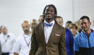 FILE - In this Sept. 24, 2015, file photo, Washington Redskins' Robert Griffin III leaves MetLife Stadium after an NFL football game against the New York Giants, in East Rutherford, N.J. The Browns have signed free agent quarterback Robert Griffin III, who hasn't been the same since his dazzling rookie season in Washington. Griffin, who didn't play a snap in 2015, was recently released by the Redskins.  (AP Photo/Kathy Willens)