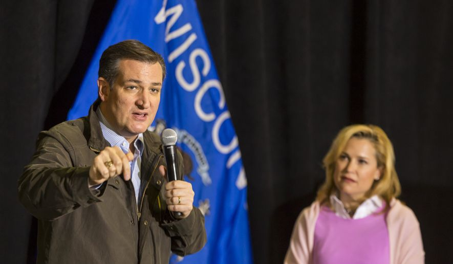 Republican presidential candidate Sen. Ted Cruz, R-Texas, speaks at a campaign stop as wife Heidi listens Thursday, March 24, 2016, in Dane, Wis. (AP Photo/Andy Manis)