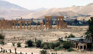 This file photo released on Sunday, May 17, 2015, by the Syrian official news agency SANA, shows the general view of the ancient Roman city of Palmyra, northeast of Damascus, Syria. (SANA via AP, File)