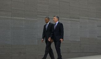 President Barack Obama and Argentine President Mauricio Macri visit Parque de la Memoria in Buenos Aires, Argentina, Thursday, March 24, 2016. Obama visited the memorial to victims of the country's murderous US-backed dictatorship who were killed or went missing from 1976-1983. (AP Photo/Pablo Martinez Monsivais)