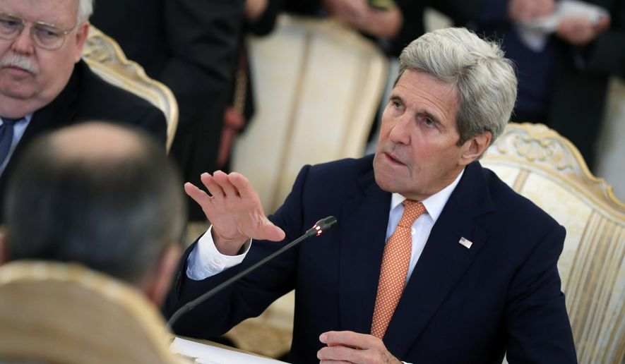 U.S. Secretary of State John Kerry, right, gestures while speaking to Russian Foreign Minister Sergey Lavrov, back to a camera, during their talks in Moscow, Russia, Thursday, March 24, 2016. Kerry is in Moscow to discuss the fragile truce in Syria that is hoped will spark U.N.-brokered peace talks. (AP Photo/Alexander Zemlianichenko)