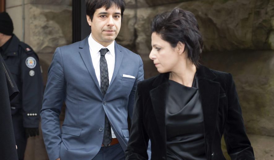 Jian Ghomeshi leaves court in Toronto on Thursday, March 24, 2016 with his lawyer Marie Henein. Ghomeshi was acquitted on all charges of sexual assault and choking following a trial that sparked a nationwide debate on how the justice system treats victims. (Frank Gunn/The Canadian Press via AP) MANDATORY CREDIT