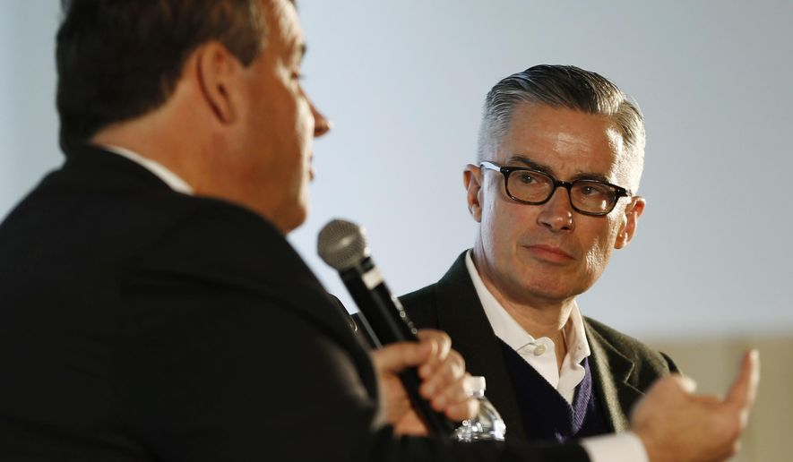 Former New Jersey Gov. Jim McGreevey, right, listens as Gov. Chris Christie speaks during a talk at the 3rd Annual Prisoner Reentry Conference, Thursday, March 24, 2016, in Jersey City, N.J. (AP Photo/Julio Cortez)