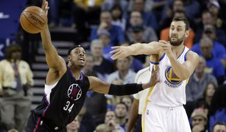 Los Angeles Clippers' Paul Pierce (34) defends on Golden State Warriors' Andrew Bogut during the first half of an NBA basketball game Wednesday, March 23, 2016, in Oakland, Calif. (AP Photo/Marcio Jose Sanchez)