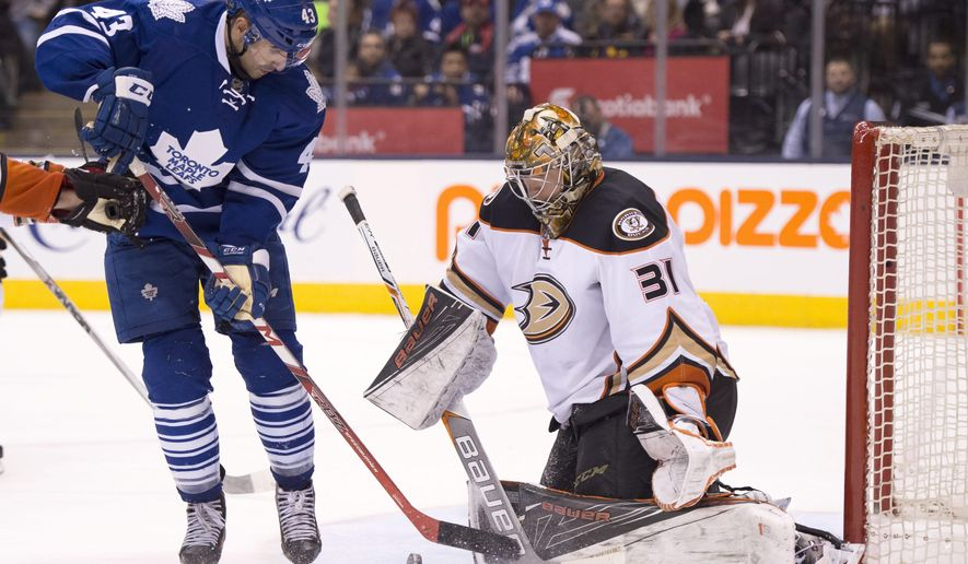 Toronto Maple Leafs centre Nazem Kadri (43) spins in on Anaheim Ducks goaltender Frederik Andersen on his way to scoring the game winning goal during overtime of an NHL hockey game, Thursday, March 24, 2016 in Toronto.  (Frank Gunn/The Canadian Press via AP) MANDATORY CREDIT