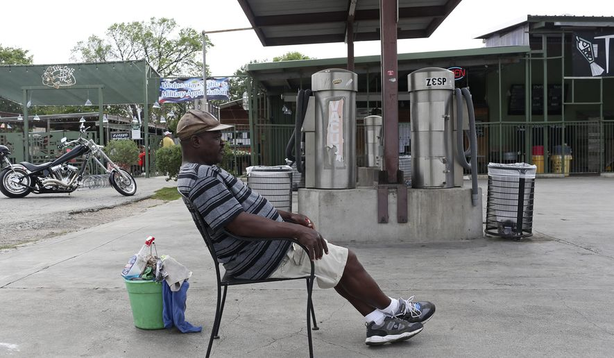 U.S. Army veteran Ivory Smith, 55, waits for cars to wash at the Cove car wash, Wednesday, March 16, 2016 in San Antonio, Texas. Smith was able to obtain six months of rent-free housing with help from Family Endeavors Navigators and the American GI Forum who were able to find an apartment for the veteran. The navigators attempt to get homeless veterans into housing and provide frequent follow-ups to check on their progress.  (Jerry Lara/The San Antonio Express-News via AP) RUMBO DE SAN ANTONIO OUT; NO SALES; MANDATORY CREDIT