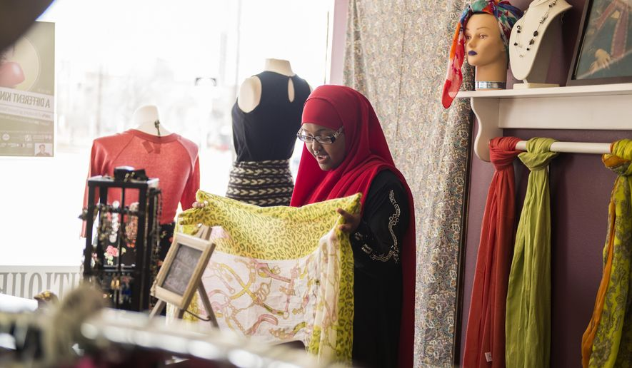 ADVANCE FOR USE MONDAY, MARCH 28, 2016, AND THEREAFTER- In this March 21, 2016, photo, Fatuma Mohammed speaks to a customer at Sisterhood Boutique in Minneapolis. Sisterhood Boutique, which celebrated its second anniversary last month, allows women ages 16-21 to take part in a four-month internship to help build and develop their business skills, The Minnesota Daily reported. (Maddy Fox/The Minnesota Daily via AP) MANDATORY CREDIT