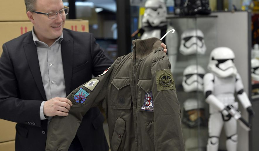 "ADVANCE FOR SATURDAY MARCH 26 AND THEREAFTER - In a March 18, 2016 photo, Dana Gasser, co-owner of Anovos, a company poses for a photo in the store in Kenosha, Wisc. Gasser has turned his love for ""Star Wars"" and attention to detail into a booming business. He ditched his corporate career seven years ago to create Anovos, a company that produces high-end, replica movie props and costumes for a growing worldwide market. Anovos is the only company licensed to sell costumes and props for ""Star Wars,"" ""Star Trek"" and ""Battlestar Galactica."" (Brian Passino/Kenosha News via AP)"