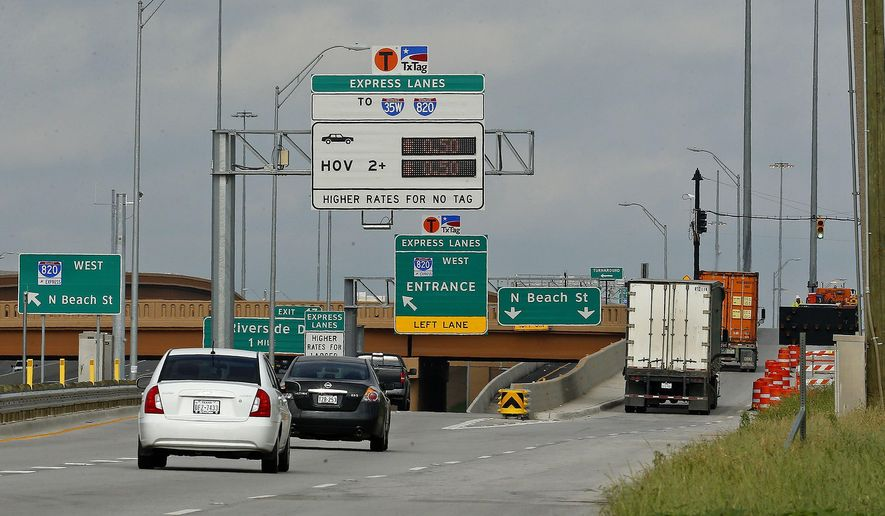 Traffic moves west along the frontage road of west bound Loop 820 near North Beach Street in Fort Worth, Texas, Monday, April 27, 2015. Nearly 50 miles of toll lanes have opened in the Fort Worth area during the past couple of years, many next to free lanes. Although the pay-as-you-go roads have become part of life in Tarrant County, many motorists say the signage distinguishing the free lanes from the toll lanes is still confusing. (Ron Jenkins/Star-Telegram via AP)  MAGS OUT; (FORT WORTH WEEKLY, 360 WEST); INTERNET OUT; MANDATORY CREDIT