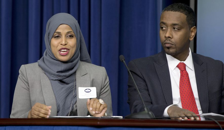 "FILE - In this Feb. 18, 2015 file photo, Hodan Hassan, left, Associate Vice President, Program Funding and Prospect Development at Save the Children US, and Minneapolis City Council Member Abdi Warsame participate in the Minneapolis-St. Paul Pilot Program presentation during the White House Summit on Countering Violent Extremism in the South Court Auditorium of the Eisenhower Executive Office Building on the White House Complex in Washington. More than a year and a half after it was first announced, the federal effort in Minneapolis, Los Angeles and Boston to combat extremist recruitment has been slow to start. Few local programs have been directly created by the ""Countering Violent Extremism"" pilot initiative. The furthest along appears to be Minneapolis, where officials point to at least one newly created but still not operational effort: a privately financed mentorship program. (AP Photo/Carolyn Kaster, File)"