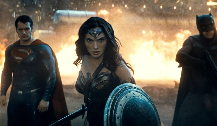 """This image released by Warner Bros. Entertainment shows Henry Cavill as Superman, left, Gal Gadot as Wonder Woman and Ben Affleck as Batman in a scene from """"Batman v Superman: Dawn of Justice."""" (Warner Bros. Entertainment via AP)"""