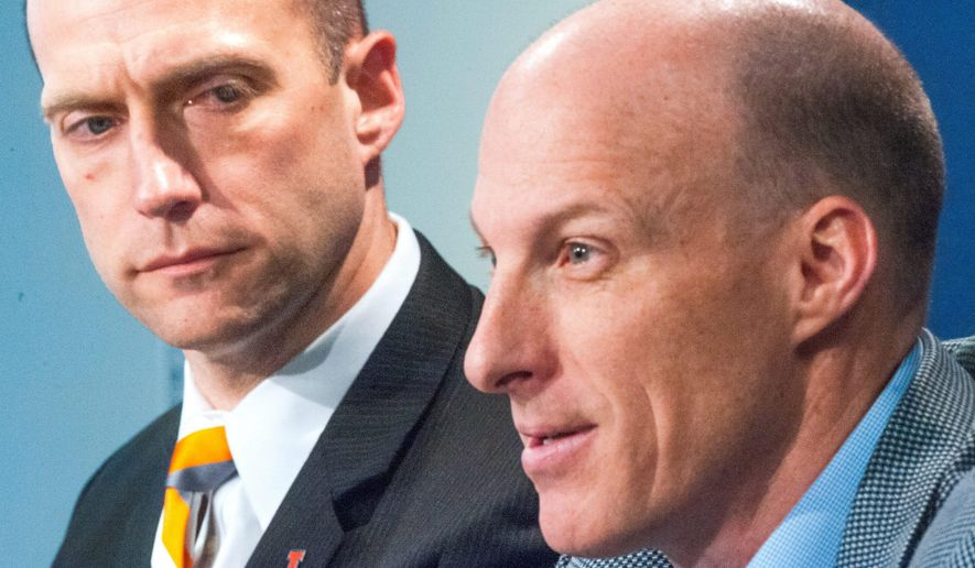 Illinois men's basketball coach John Groce, speaks during an NCAA college basketball press conference with UI athletic director Josh Whitman, left, Thursday, March 24, 2016, at Memorial Stadium in Champaign, Ill. (Robin Scholz/The News-Gazette via AP)  MANDATORY CREDIT