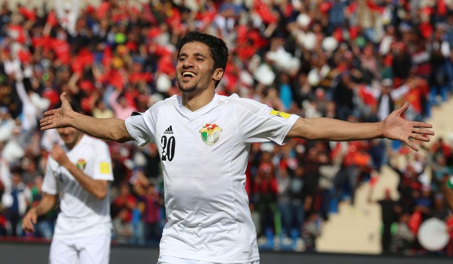Jordan's forward Hamza Aldaradreh celebrates after scoring during their World Cup 2018 Asian qualifying football match against Bangladesh in Amman, Jordan, Thursday, March 24, 2016. Jordan won 8-0. (AP Photo/Raad Adayleh)