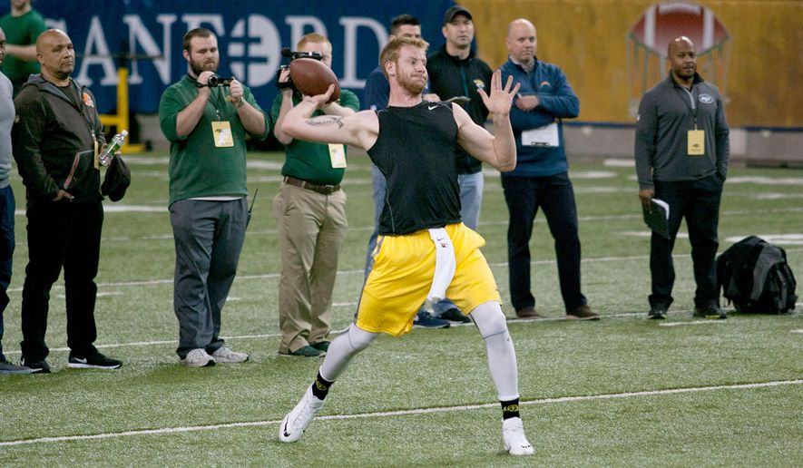 North Dakota State quarterback Carson Wentz throws a pass during the school's NFL football pro day, Thursday, March 24, 2016, in Fargo, N.D. (AP Photo/Bruce Crummy)