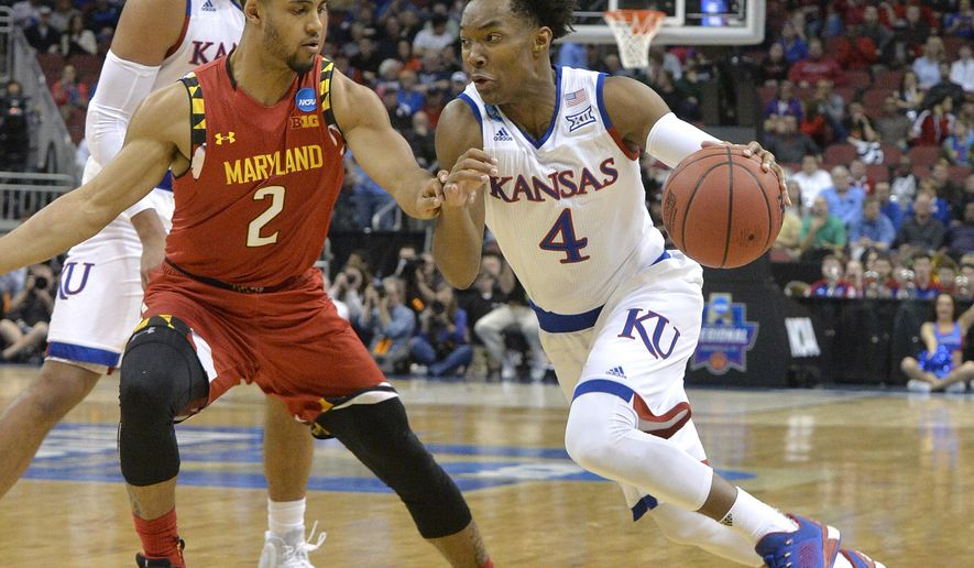 Kansas guard Devonte' Graham (4) drives against Maryland guard Melo Trimble (2) during the first half of an NCAA college basketball game in the regional semifinals of the men's NCAA Tournament in Louisville, Ky., Thursday, March 24, 2016. (AP Photo/Timothy D. Easley)