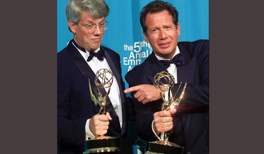 "FILE - In this Sept. 13, 1998 file photo, Peter Tolan, left, and Garry Shandling pose with their Emmy awards for outstanding writing for a comedy series award for ""The Larry Sanders Show,""  at the 50th Annual Primetime Emmy Awards in Los Angeles. Shandling, who as an actor and comedian pioneered a pretend brand of self-focused docudrama with ""The Larry Sanders Show,"" died, Thursday, March 24, 2016 of an undisclosed cause in Los Angeles. He was 66. (AP Photo/Victoria Arocho, File)"