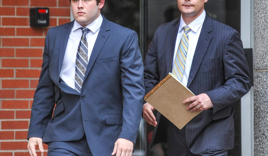Former University of Mississippi student Austin Reed Edenfield, left, with attorney Clark Trout, leaves federal court Thursday, March 24, 2016, after pleading guilty to placing a noose on the school's statue of its first black student, in Oxford, Miss. Edenfield waived indictment and pleaded guilty to a misdemeanor charge before U.S. District Judge Michael Mills. The charge says Edenfield helped others threaten force to intimidate African-American students and employees at the university. Edenfield will be sentenced on July 21 and faces up to a year in prison and a $100,000 fine. The government has recommended probation. (Bruce Newman/Oxford Eagle via AP)